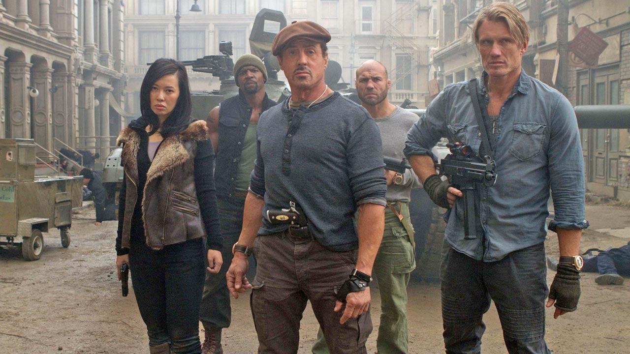 Sylvester Stallone, Jason Statham, Terry Crews, Nan Yu and Randy Couture appear in a scene from the 2012 movie The Expendables 2.