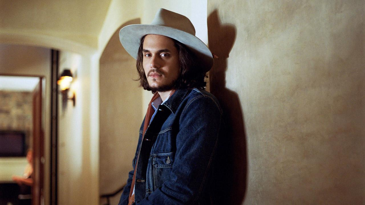 John Mayer appears in a 2012 promotional photo for his single, Shadow Days, which is from his album Born and Raised. The record was released in May.