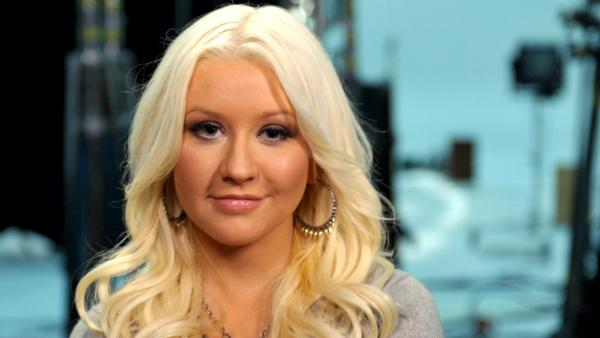 In this photo released on Tuesday, July 31, 2012, Christina Aguilera uses her voice for good in the fight against hunger by filming a new PSA for Yum! Brands World Hunger Relief in Los Angeles. - Provided courtesy of John Shearer/Invision for Yum!/AP Images