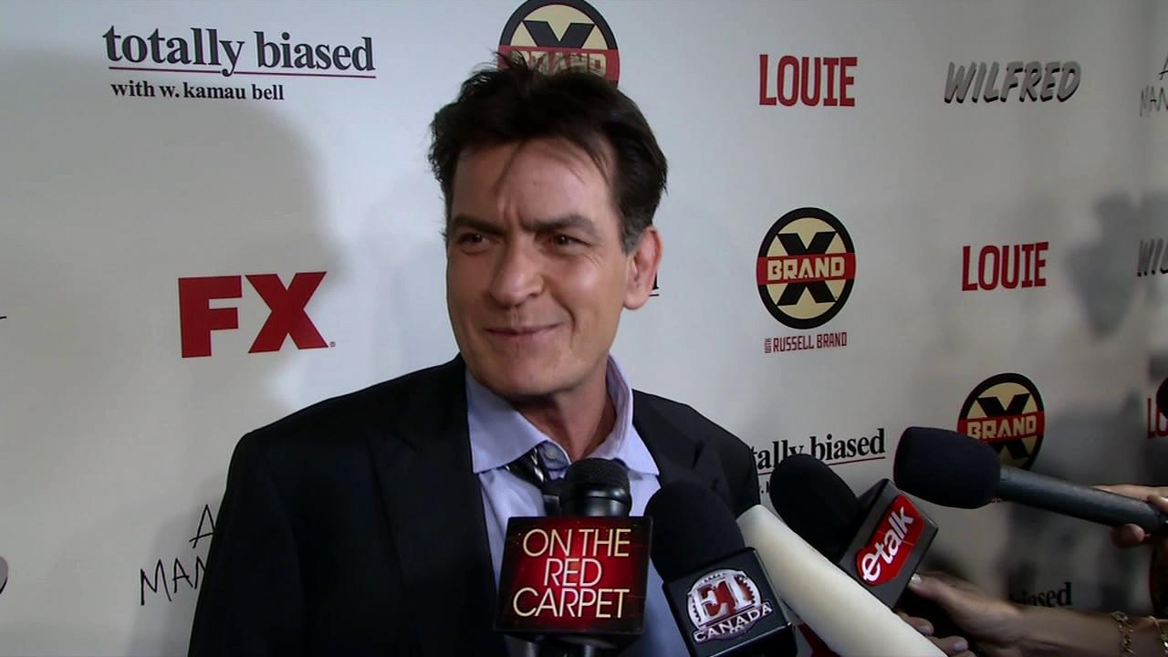 Charlie Sheen talks to OnTheRedCarpet.com at the premiere of his new FX show, Anger Management, in Los Angeles on June 26, 2012.