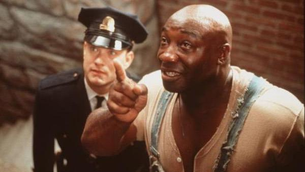 Michael Clarke Duncan (right) and Tom Hanks appear in a scene from the 1999 movie 'The Green Mile.'
