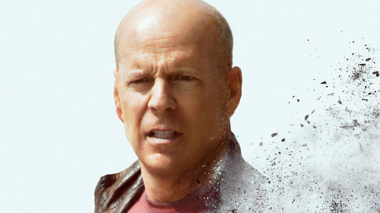 Bruce Willis appears in a promotional photo for the 2012 film, Looper.