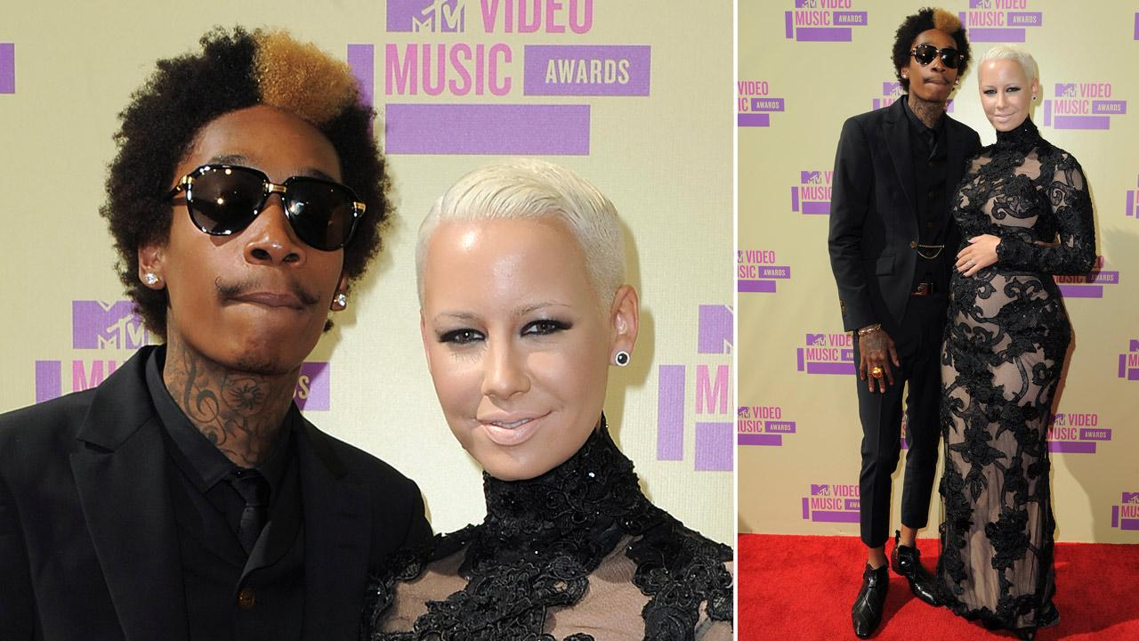 Wiz Khalifa and Amber Rose, who is pregnant with their first child, arrive at the MTV Video Music Awards on Thursday, Sept. 6, 2012, in Los Angeles.