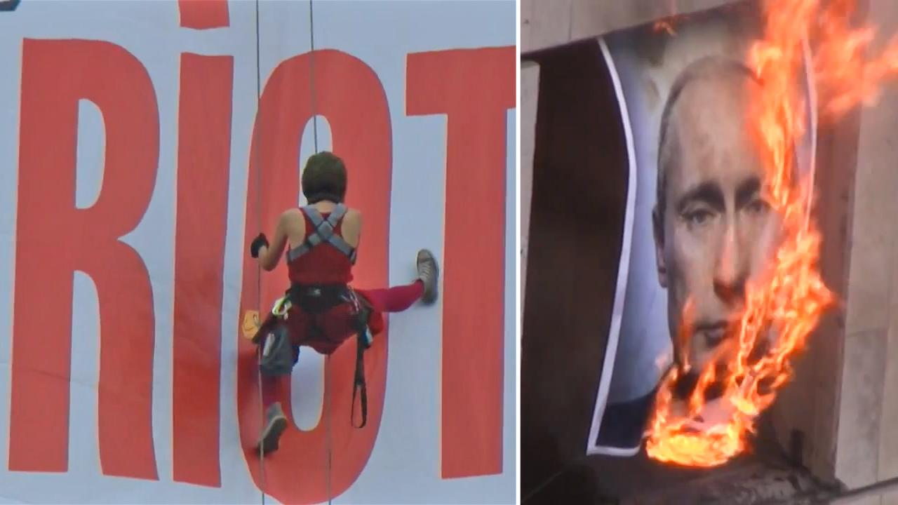 Members of feminist punk group Pussy Riot appear in a YouTube video uploaded on September 6, 2012. / A burning image of Vladimir Putin appears in a YouTube video uploaded on September 6, 2012.