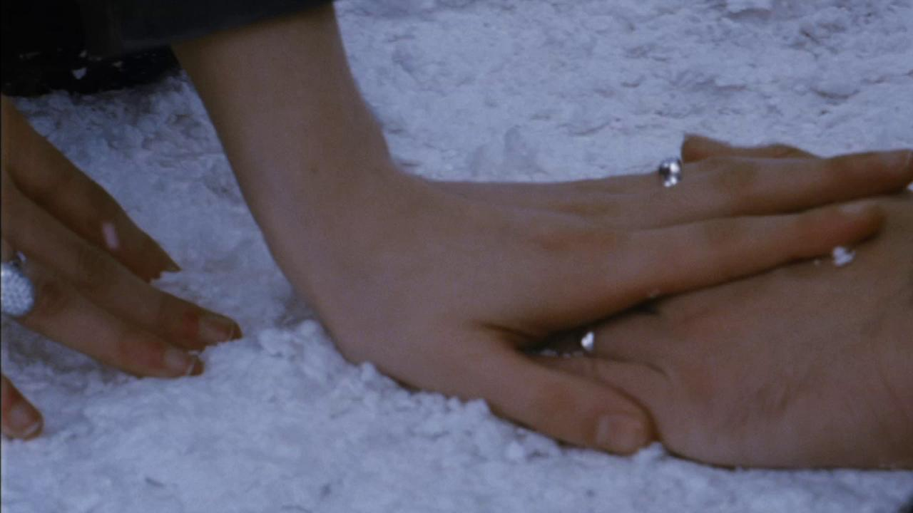 Bella and Edward (Kristen Stewart and Robert Pattinson) hold hands and show their wedding rings in a scene from the 2012 movie The Twilight Saga: Breaking Dawn - Part 2.Summit Entertainment