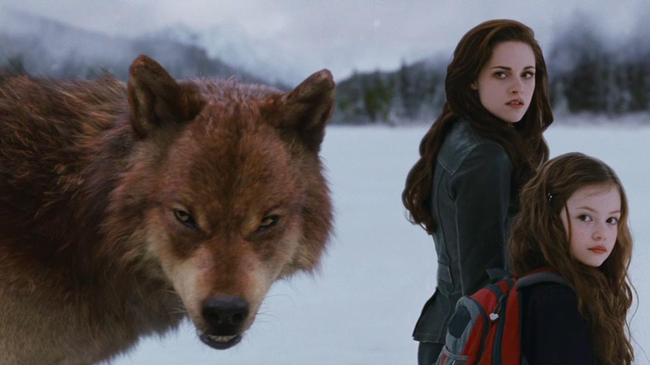 Bella and Renesmee (Kristen Stewart and Mackenzie Foy) and a werewolf appear in a scene from the 2012 movie The Twilight Saga: Breaking Dawn - Part 2.Summit Entertainment
