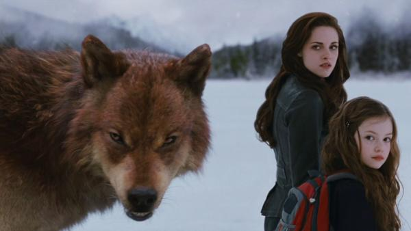 Bella and Renesmee (Kristen Stewart and Mackenzie Foy) and a werewolf appear in a scene from the 2012 movie 'The Twilight Saga: Breaking Dawn - Part 2.'
