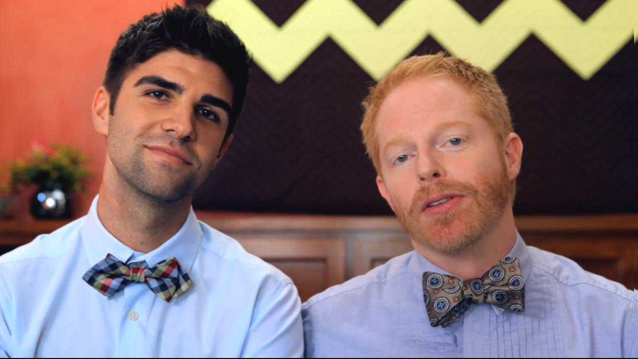 Jesse Tyler Ferguson and his fiance Justin Mikita appear in a still from their Tie the Knot foundation video.