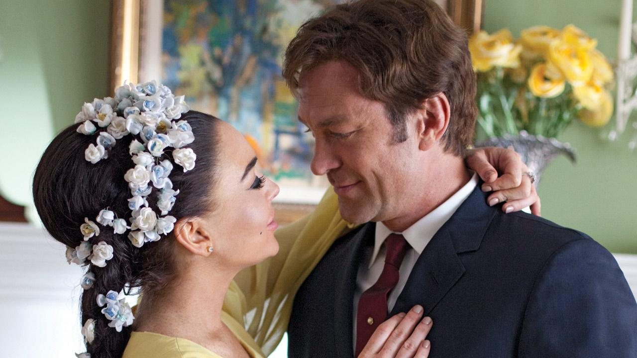 Lindsay Lohan and Grant Bowler appear in an official photo from the Lifetime Original Movie, Liz & Dick.