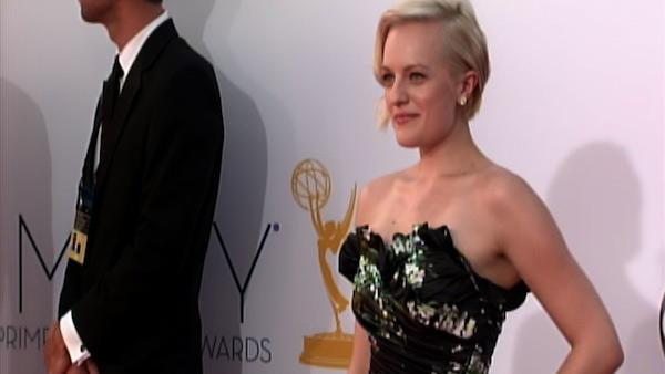 Elisabeth Moss poses on the Emmys red carpet