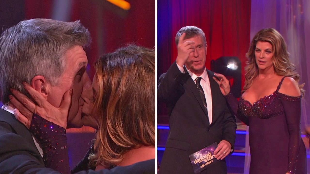 Kirstie Alley kisses Tom Bergeron on the premiere of Dancing With The Stars: All-Stars on Sept. 24, 2012. She said it was to celebrate his Emmy win from the night before.