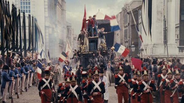The students appear on the barricade in a scene from the 2012 movie 'Les Miserables.'