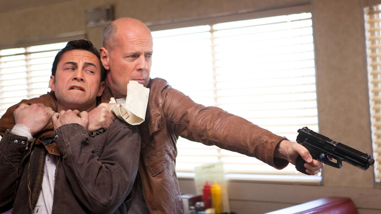 Joseph Gordon-Levitt and Bruce Willis appear in a scene from the 2012 film Looper.