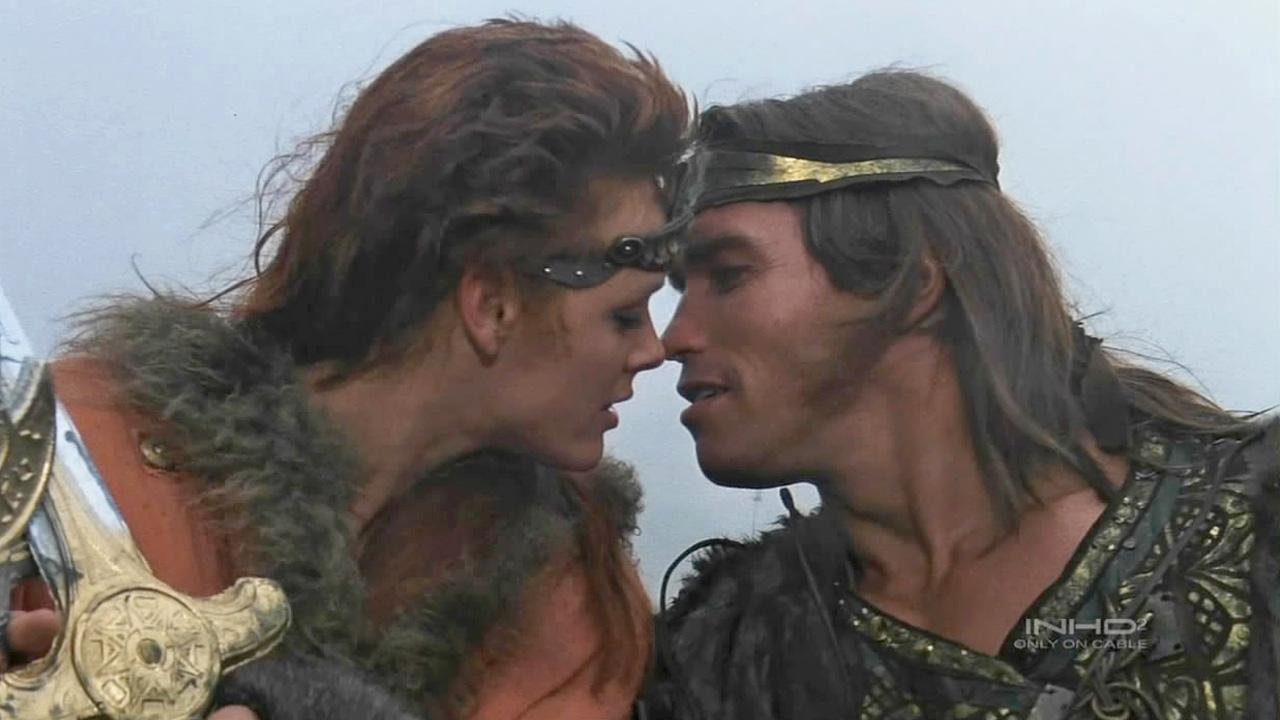 Arnold Schwarzenegger and Brigitte Nielsen appear in a still from the 1985 film, Red Sonja.