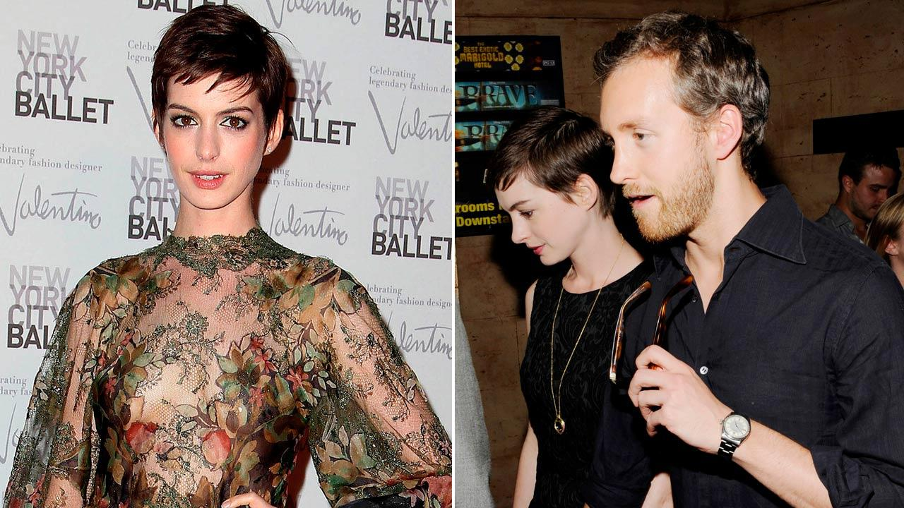 Anne Hathaway arrives at the New York City Ballet Fall Gala honoring fashion designer Valentino Garavani at Lincoln Center in New York on Sept. 20, 2012. / Actress Anne Hathaway and fiance Adam Shulman attend a special screening on Tuesday July 10, 2012.