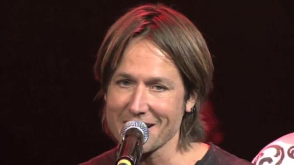 Keith Urban is surprised on stage at the 'All For The Hall' benefit concert at Bridgestone Arena on April 10, 2012 with a microphone stand symbolizing his invitation to join the Grand Ole Opry.