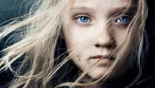 Isabelle Allen appears as young Cosette on the official poster for the 2012 film Les Miserables.