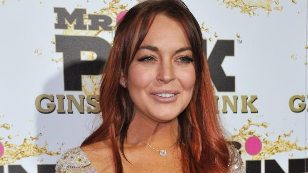 Lindsay Lohan attends the Mr. Pink Ginseng launch party at the Beverly Wilshire hotel on Thursday, Oct. 11, 2012, in Beverly Hills, Calif. - Provided courtesy of Richard Shotwell / Invision / AP