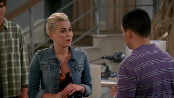 Ashton Kutcher, Miley Cyrus and Jon Cryer appear in a still from Two and a Half Men. - Provided courtesy of CBS