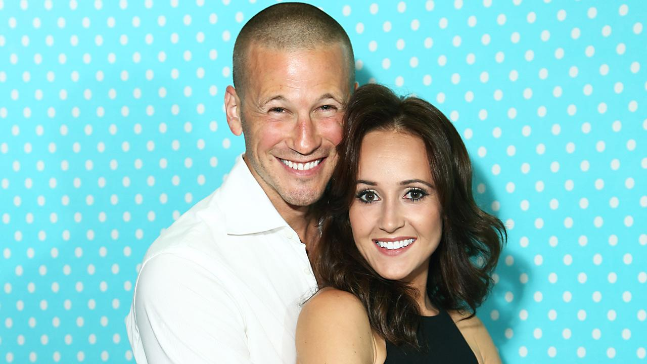 Ashley Hebert and J.P. Rosenbaum appear in an undated photo from their official website.