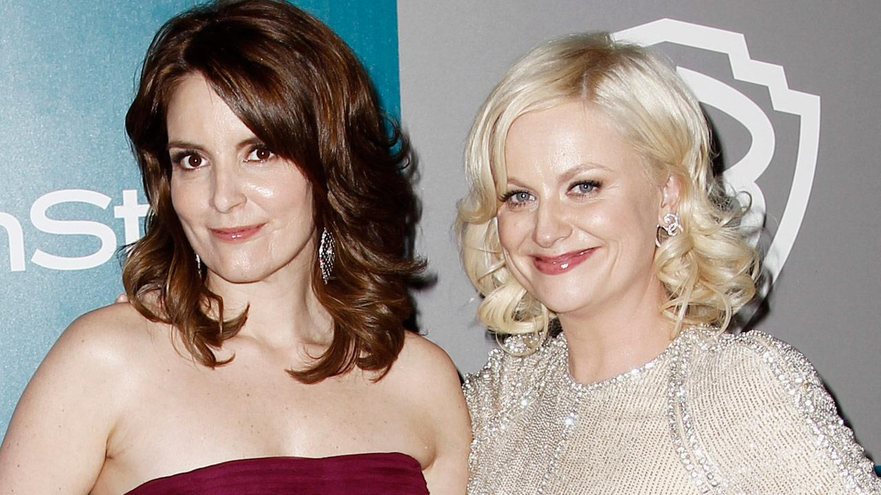 Tina Fey, left, and Amy Poehler arrive at the 2012 Warner Bros. and InStyle Golden Globe After Party at the Beverly Hilton in Los Angeles. on Sunday, Jan. 15, 2012.