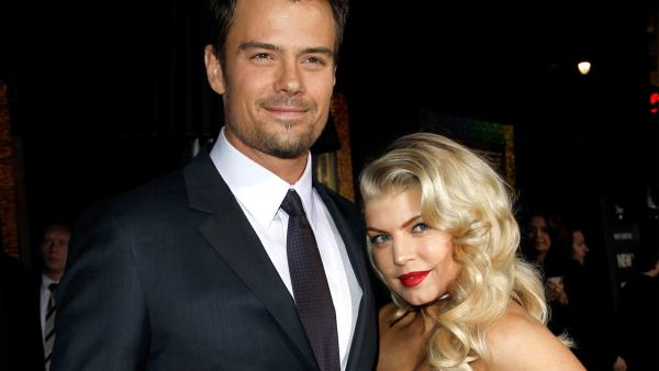 Josh Duhamel, left, and Fergie arrive at the premiere of New Years Eve in Los Angeles on Monday, Dec. 5, 2011. - Provided courtesy of AP / Matt Sayles