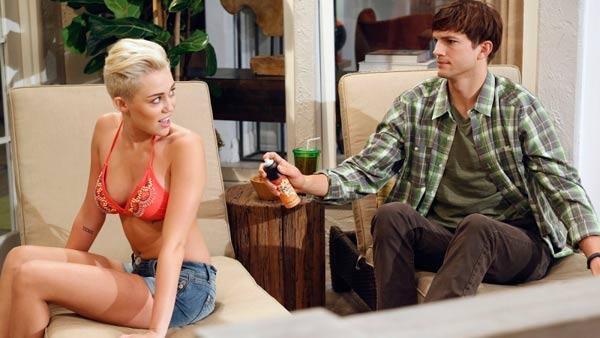Ashton Kutcher and Miley Cyrus appear in a scene from an episode of Two and a Half Men that aired on CBS on Oct. 18, 2012. - Provided courtesy of Greg Gayne / Warner Bros. Television / CBS