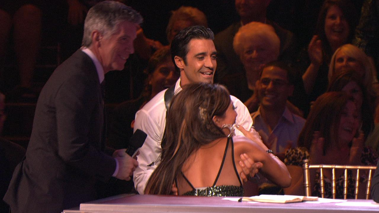 Gilles Marini helps Carrie Ann Inaba after she falls from her chair on Dancing With The Stars: All-Stars, which aired on October 22, 2012.ABC