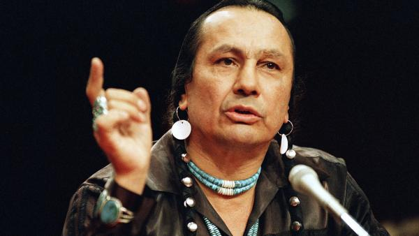In a Jan. 31, 1989 file photo, Russell Means testifies before a special investigative committee of the Senate Select Committee on Capitol Hill, in Washington.