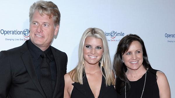 Singer Jessica Simpson, center, her father Joe Simpson, right, and mother Tina Simpson arrive at the Operation Smile 'Smile Gala' in Beverly Hills, Calif. on Friday, Oct. 2, 2009.