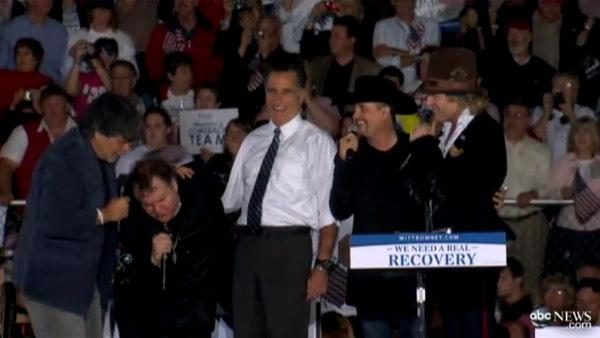 Republican presidential candidate and former Massachusetts Governor Mitt Romney sings 'America The Beautiful' with Meat Loaf as he campaigns at the football stadium at Defiance High School in Defiance, Ohio on Thursday, Oct. 25, 2012.