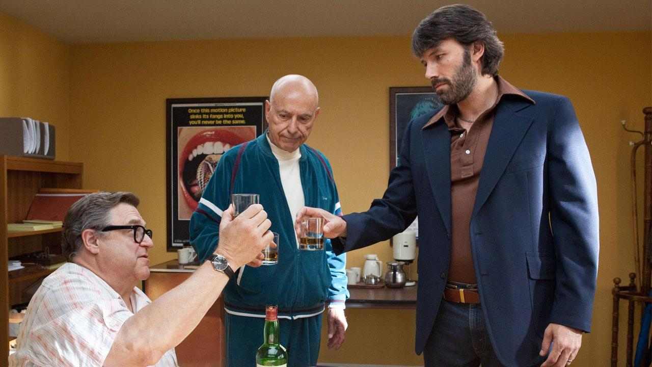 Ben Affleck, Alan Arkin and John Goodman appear in a scene from the 2012 movie Argo.