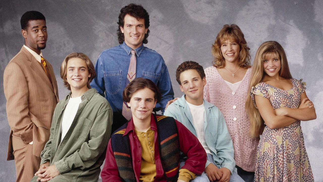 The cast of Boy Meets World, including Ben Savage, Rider Strong, Danielle Fishel, Betsy Randle and Will Friedle, appear in a promotional photo.