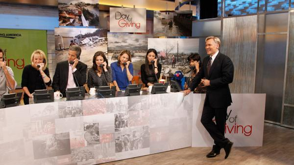 Cameron Mathison, Diana Williams, Dr. Richard Besser, Bianna Golodryga, Ginzer Zee, Liz Cho, Grover and Maria from Sesame Street and Sam Champion appear on Good Morning America during its Day of Giving to benefit survivors of Superstorm Sandy. - Provided courtesy of ABC / Lou Rocco