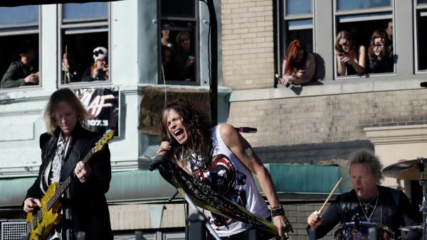 Aerosmith performs a free concert in Boston front of the rockers former apartment in Boston on Nov. 5, 2012. - Provided courtesy of AP / Elise Amendola