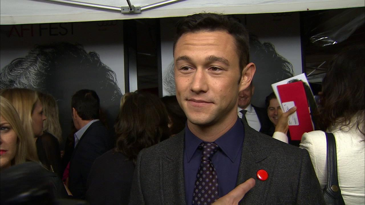 Joseph Gordon-Levitt points to his Record button on his suit at the premiere of Lincoln at Graumans Chinese Theatre during AFI Fest in Hollywood on Nov. 8, 2012.
