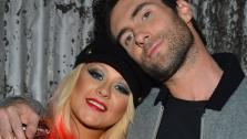The Voice coaches Christina Aguilera and Adam Levine appear at the House of Blues in Los Angeles on Nov. 8, 2012 for the NBC shows special concert to celebrate the announcement of the top 12. - Provided courtesy of Frazer Harrison / NBC