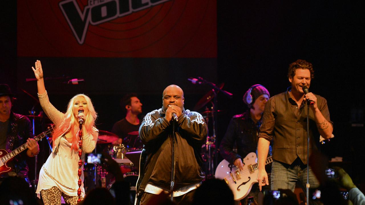 The Voice coaches Christina Aguilera, Cee Lo Green and Blake Shelton perform at the NBC shows special concert to celebrate the announcement of the top 12, held at the House of Blues in Los Angeles on Nov. 8, 2012.