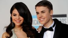 Selena Gomez, left, and Justin Bieber arrive at the 39th Annual American Music Awards on Sunday, Nov. 20, 2011 in Los Angeles. - Provided courtesy of AP / Chris Pizzello