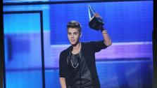 Justin Bieber appears on stage after winning an award at the 40th Anniversary American Music Awards on Sunday, Nov. 18, 2012, in Los Angeles. - Provided courtesy of ABC / Todd Wawrychuck