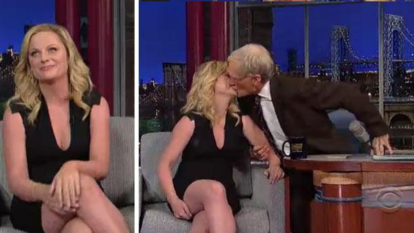 Dave Letterman kisses Amy Poehler on an episode of the CBS series The Late Show that aired on Nov. 20, 2012. - Provided courtesy of CBS / Worldwide Pants