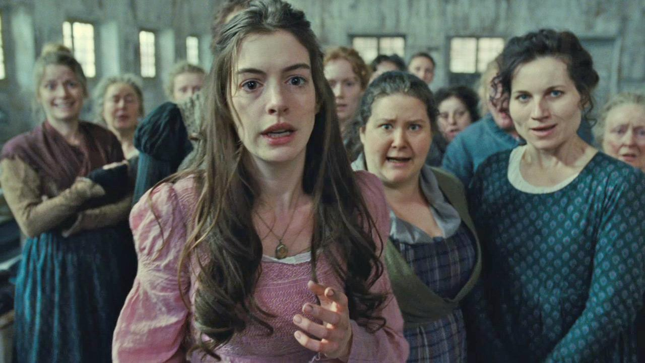Fantine (Anne Hathaway) and others sing At The End Of The Day in this scene from Les Miserables.Universal Pictures / Working Title Films / Cameron Mackintosh Ltd.