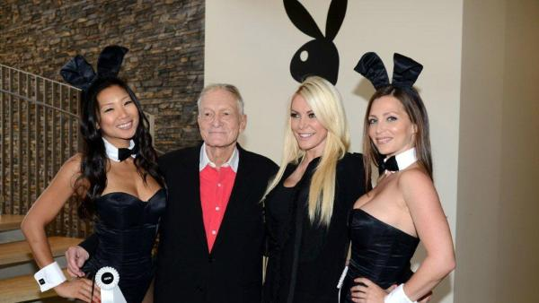 Hugh Hefner and Crystal Harris pose with Playboy Bunnies at the Beverly Hills City Council and Playboy Enterprises ribbon-cutting ceremony for Beverly Hills Playboy World Headquarters on Aug. 7, 2012.
