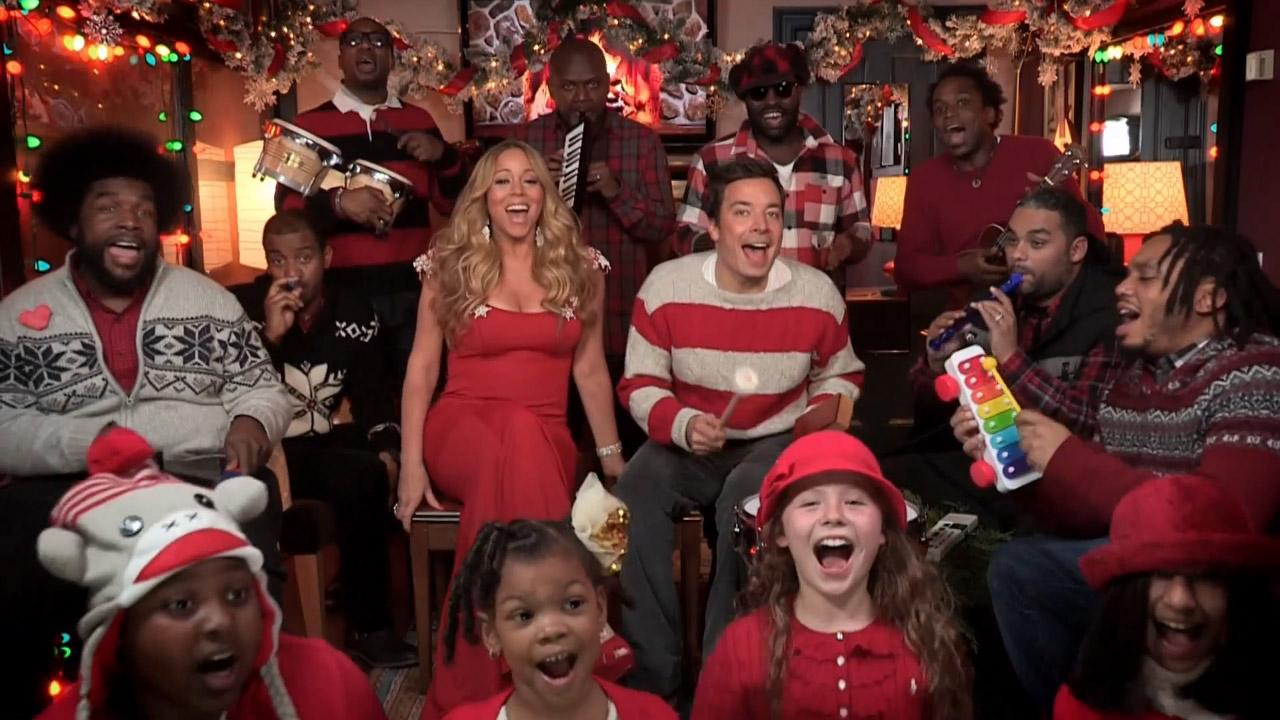 Mariah Carey sings while Jimmy Fallon and the Roots perform on the NBC show Late Night with Jimmy Fallon on Dec. 4, 2012.