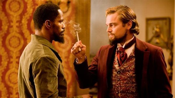 Jamie Foxx and Leonardo DiCaprio appear in a scene from the 2012 movie Django Unchained. - Provided courtesy of Andrew Cooper / The Weinstein Company
