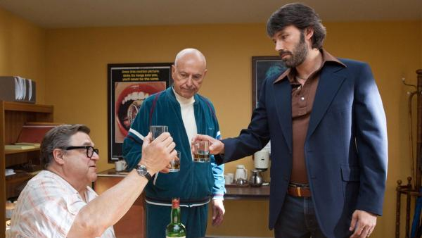 Ben Affleck, Alan Arkin and John Goodman appear in a scene from the 2012 movie 'Argo.'