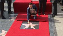 Hugh Jackman appears with his star on the Hollywood Walk of Fame on December 13, 2012. - Provided courtesy of OTRC