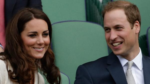 Britain's Prince William, right, and Kate, Duchess of Cambridge watch Roger Federer of Switzerland play Mikhail Youzhny of Russia during a quarterfinals match at the All England Lawn Tennis Championships at Wimbledon, England, Wednesday July 4, 2012.