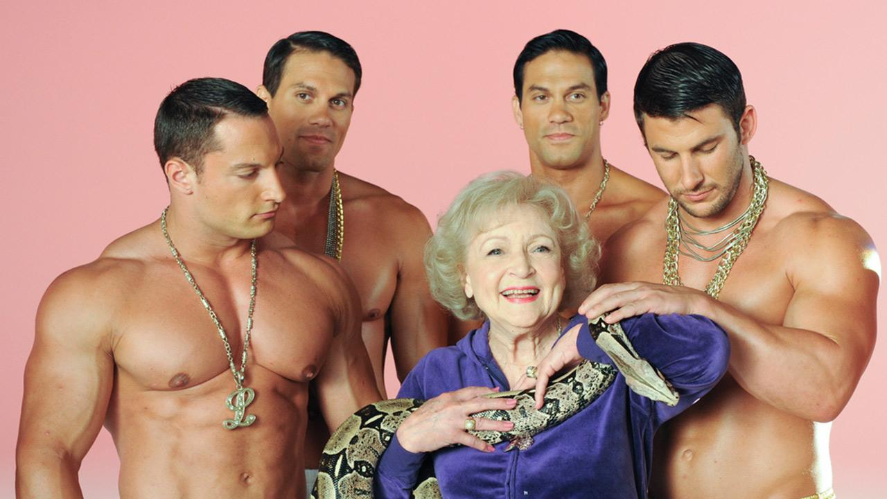Betty White appears with a group of shirtless men and a red-tailed boa constrictor on the set of her 2011 music video Im Still Hot. <span class=meta>(The Lifeline Project)</span>