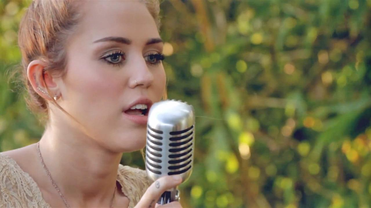 Miley Cyrus appears in a video for Jolene filmed in the summer of 2012.